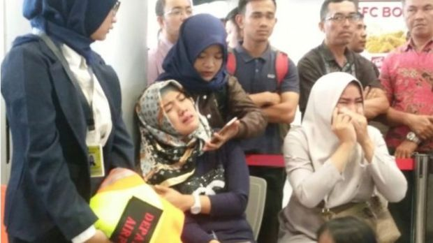 Emotional relatives wait at Depati Amir airport in Pangkal Pinang