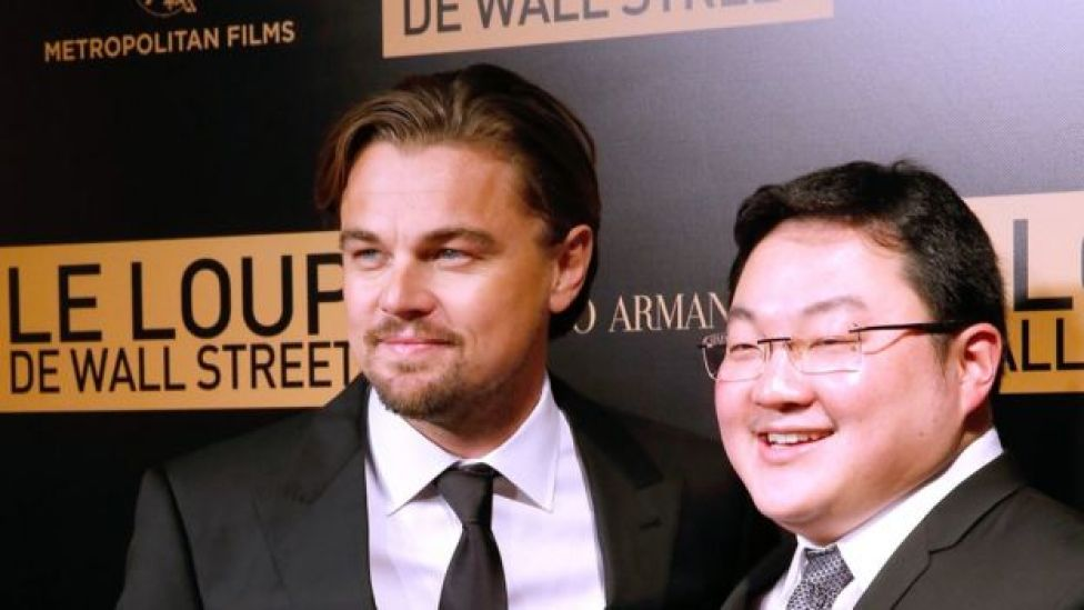 Actor Leonardo DiCaprio with Jho Low (right) of the movie attend the photocall before the 'The Wolf of Wall Street' World movie Premiere at Cinema Gaumont Opera on December 9, 2013 in Paris, France.