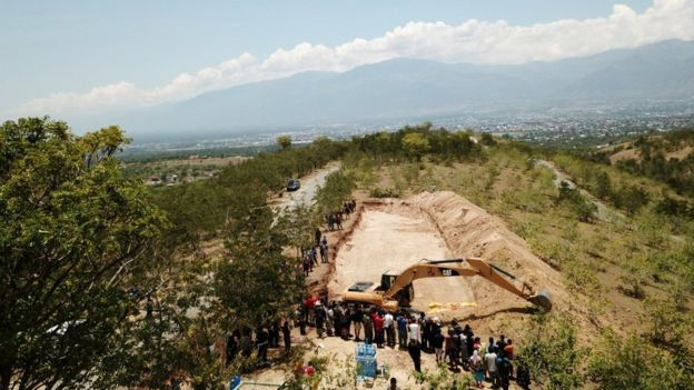 A view of a mass grave for victims of the earthquake and tsunami near Palu, Central Sulawesi,