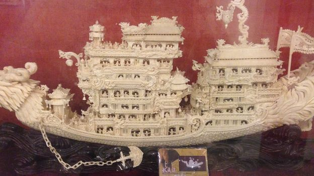 A carved ivory ship model, with an ID card that does not match, in a legal ivory shop (BBC)