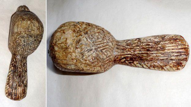 figurilla de pájaro colmillo de mamut