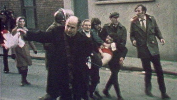 Fr Edward Daly leading a group of people carrying the dying body of Jack Duddy, shot by soldiers in Derry on Bloody Sunday, 30 January 1972