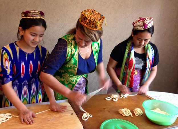 Uighurs making noodles in Kazakhstan