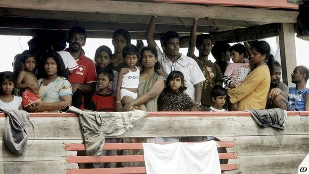 In this October 14, 2009, file photo, Sri Lankan migrants bound for Australia remain on board their boat docked at a port in Cilegon, Banten province, Indonesia, after they were intercepted by the Indonesian navy