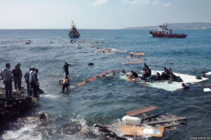 Illegal migrants arriving at Zefyros beach at Rhodes island, in Greece