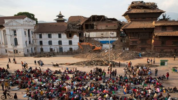 People gather on an open space for security reasons at the Basantapur Durbar Square, damaged in Saturday's earthquake in Kathmandu, Nepal (April 26, 2015)