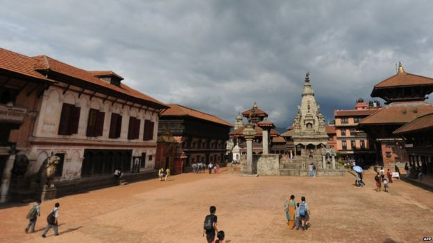 Nepalese pedestrians pass through Bhaktapur Durbar Square in Bhaktapur (July 21, 2011)