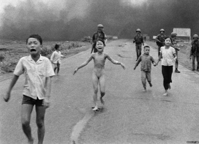 Vietnamese children fleeing a napalm attack