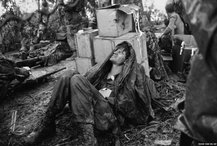 A US paratrooper wounded in the battle for Hamburger Hill awaits medical evacuation at base camp near the Laotian border on 19 May 1969