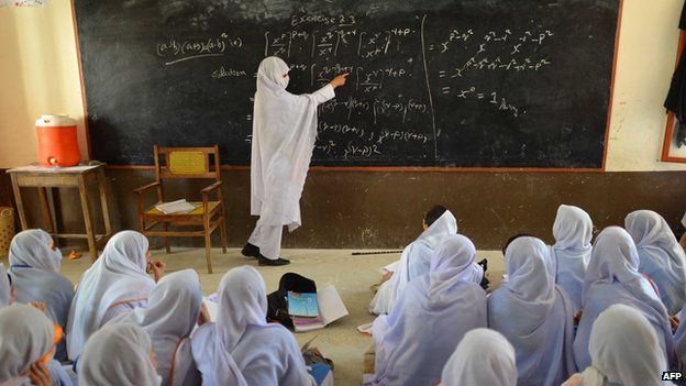 A Pakistani teacher leading a class of girls at a school in Mingora, the main town of Swat valley (July 2013)
