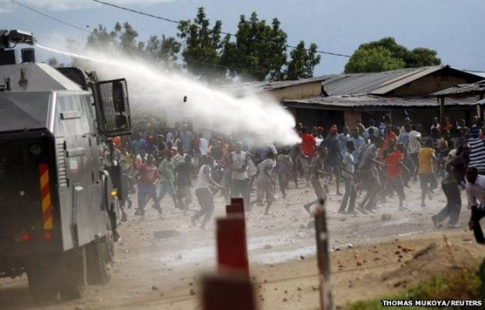 A water cannon is used by riot policemen to disperse protesters in Bujumbura