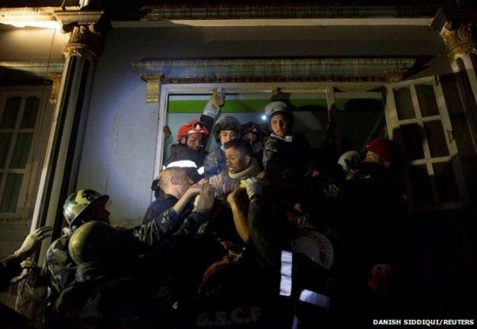 Rishi Khanal, 27, an injured survivor is rescued by French rescue teams from a damaged building following the earthquake in Kathmandu, Nepal
