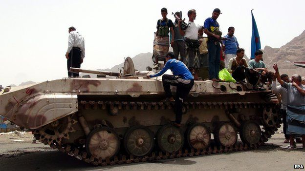 Southern Yemenis stand atop a tank of tribal militiamen loyal to Yemeni President Hadi following clashes with Houthi in Aden on 8 April, 2015