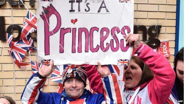 Royal fans celebrate outside St Mary's Hospital