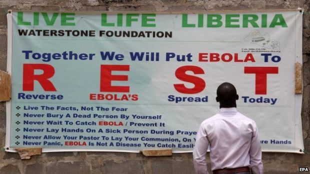 A man reads an Ebola awareness poster near Monrovia