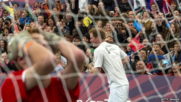 Prince Harry celebrates scoring the winning goal