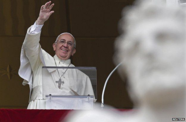 The Pope waving