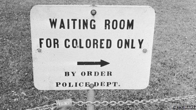 """Sign reading: """"Waiting room for colored only by order of police dept."""""""