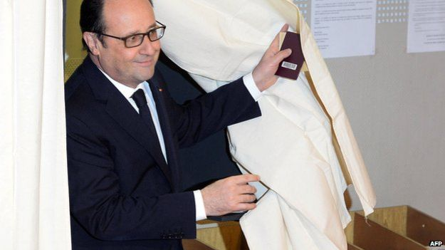 Francois Hollande leaves polling booth