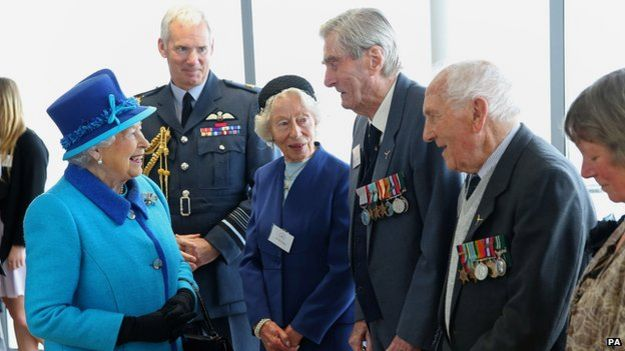 Queen meets Mrs K Foster (left), Wing Commander Paul Farnes (centre) and Squadron Leader Tom Pickering