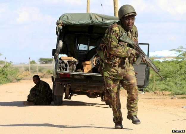 Kenya Defence Force soldier runs for cover at Garissa campus, 2 Apr 15