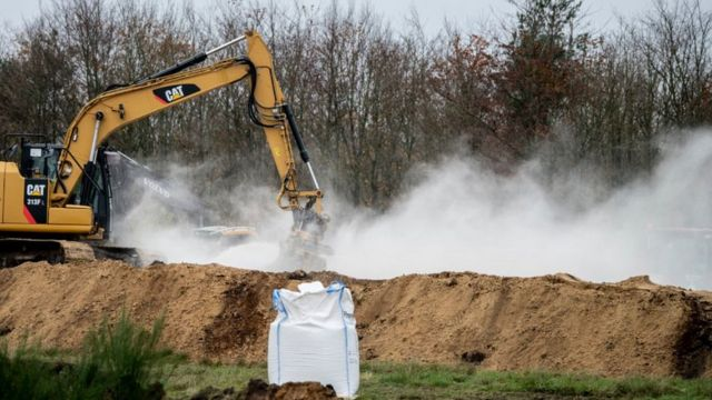 """Digging machines overturning piles of dead minks into trenches """"Jutland"""""""