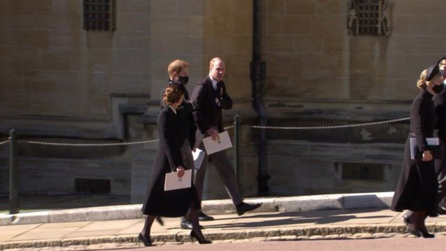 The Duke and Duchess of Cambridge are seen chatting with the Duke of Sussex after the funeral ceremony