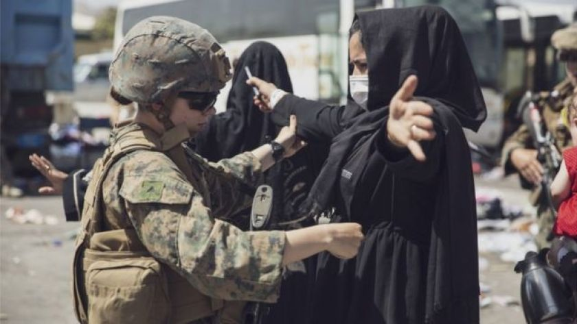 Afghan woman passes through US control to enter Kabul airport