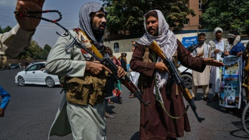 Taliban militants mobilize to control a crowd in Kabul on August 19, 2021