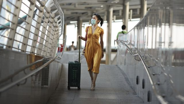 woman in airport mask