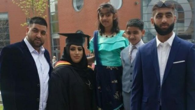Arima with her husband and children at her graduation ceremony from the University of Wolverhampton