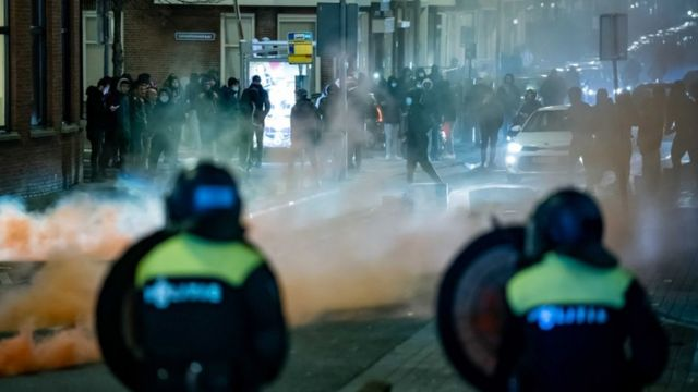 Groups of young men confront the police in Rotterdam