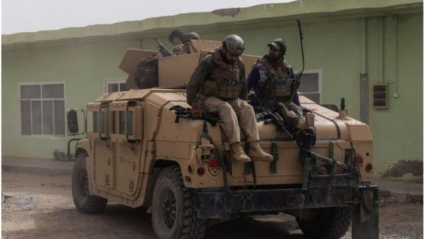 Photo shows Afghanistan troops with humvees - vehicles now in Taliban possession