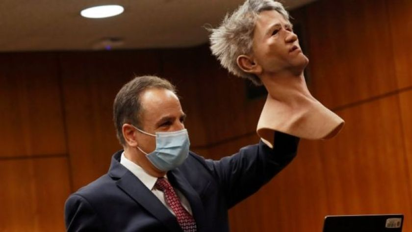 Attorney Habib A. Balian lifts a mask in court