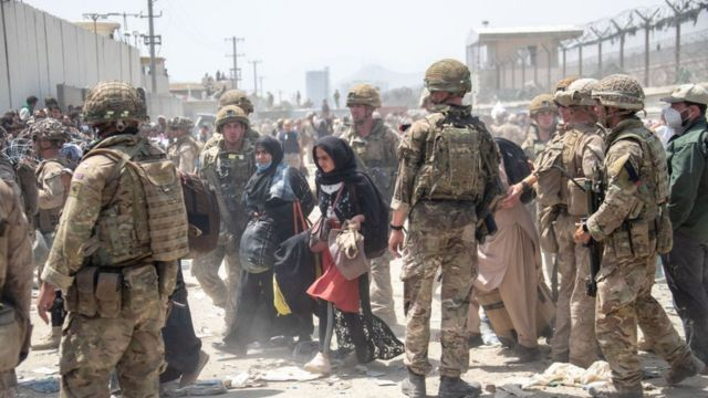 British armed forces work with the US military to evacuate eligible civilians and their families out of the country on August 21, 2021 in Kabul