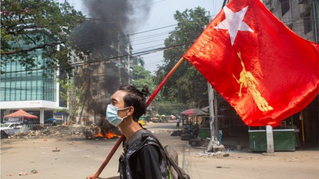 A man with a National League for Democracy flag in Yangon