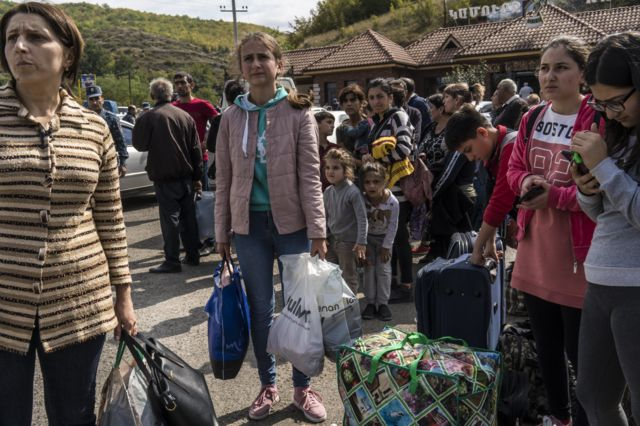 Residents of Nagorno-Karabakh prepare to flee the fighting