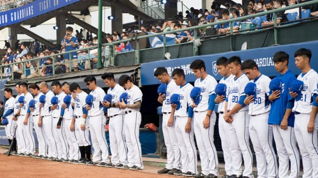 Players from Fubon Guardians pay respects for train crash victims in Taiwan, 2 April