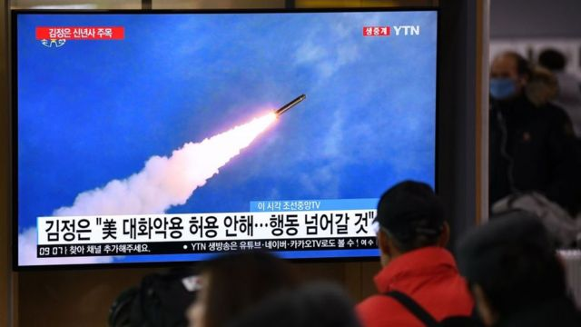 A group of people in South Korea watch the launch of a North Korean missile on television.