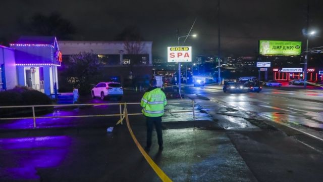 Atlanta Police Department officers investigate the scene of a shooting outside a spa on Piedmont Road in Atlanta, Georgia, USA, 16 March 2021