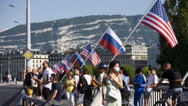 Flags of the US and Russia wave on the Mont Blanc bridge, a day prior to the US-Russia summit in Geneva, Switzerland, 15 June 2021.