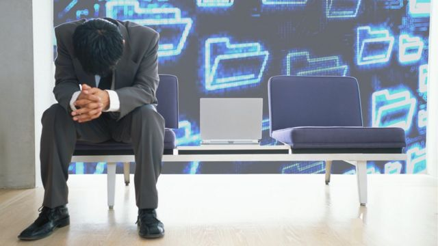 Man who's been hacked sitting with head hung
