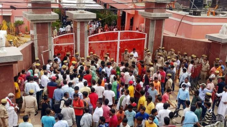 People gathered outside the monastery after the death of Narendra Giri