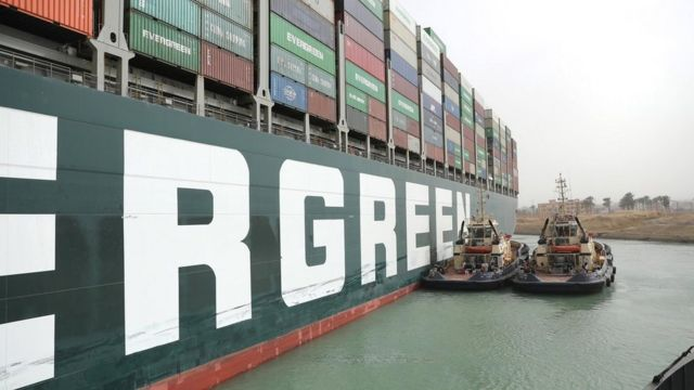 Tug boats trying to move container tanker
