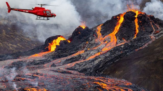 Helicopter at the site of a lava explosion
