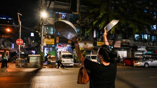 Residents bang cooking pots in protest in Yangon on Wednesday