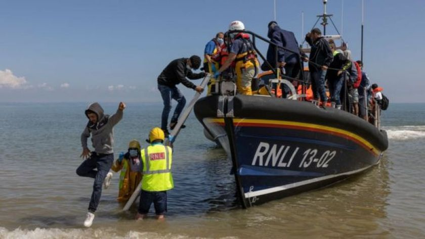 A group of about 40 migrants arrive via the RNLI (Royal National Lifeboat Institution) at Dungeness Beach on August 4, 2021