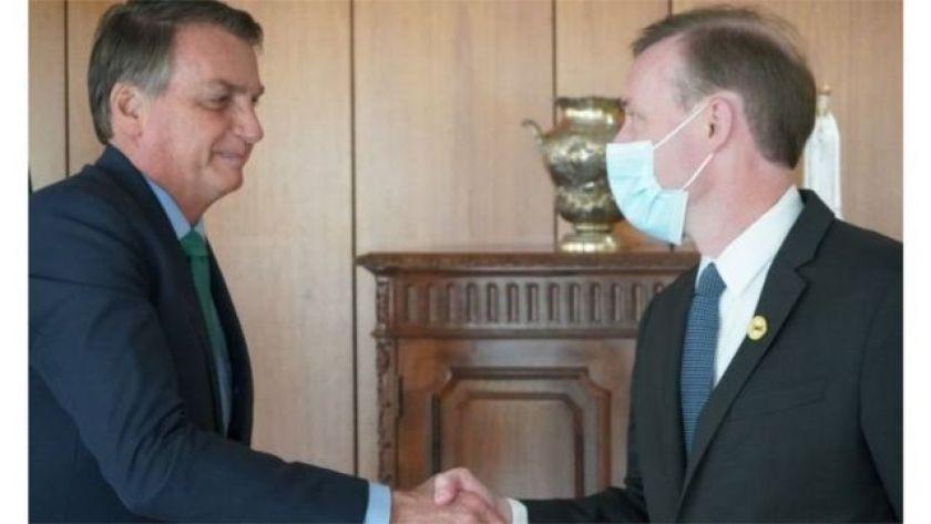 Brazilian President Jair Bolsonaro greets US National Security Adviser Jake Sullivan at Planalto Palace