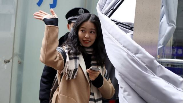 Zhou Xiaoxuan, also known by her online name Xianzi, waves as she enters a court for a sexual harassment case involving a Chinese state TV host, in Beijing, China December 2, 2020.