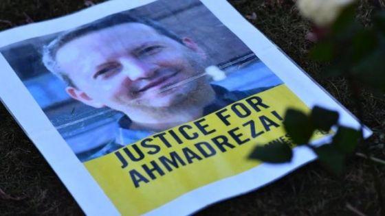 Foto pedindo justiça para Ahmadreza.